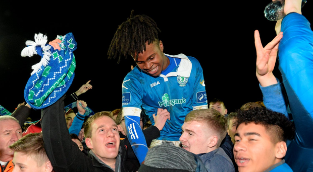 BJ Banda, Finn Harps, celebrates with fans after scoring the winning goal late in the game. SSE Airtricity League Promotion / Relegation Play-off, Second Leg, Finn Harps v Limerick FC, Finn Park, Ballybofey, Co. Donegal. Picture credit: Oliver McVeigh / SPORTSFILE