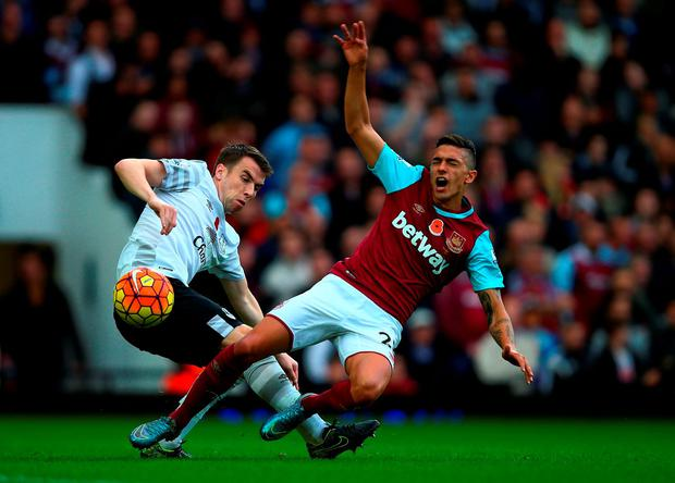 Manuel Lanzini of West Ham United is brought down by Seamus Coleman of Everton during the Barclays Premier League match between West Ham United and Everton at Boleyn Ground on November 7, 2015 in London, England. (Photo by Clive Rose/Getty Images)