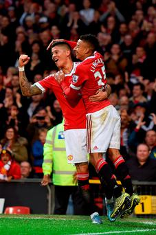 Manchester United's Jesse Lingard celebrates scoring their first goal of the game with team-mate Marcos Rojo