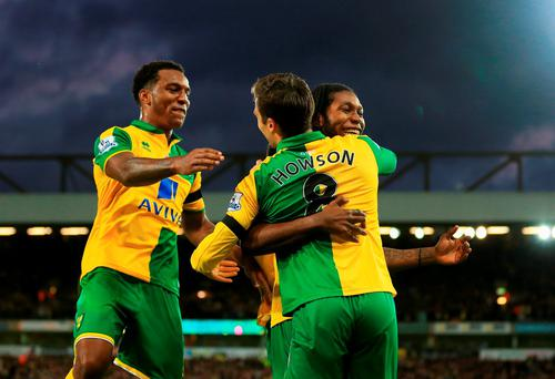 Jonathan Howson (C) of Norwich City celebrates scoring his team's first goal with his team mate Dieumerci Mbokani (R) and Alexander Tettey (L) during the Barclays Premier League match between Norwich City and Swansea City at Carrow Road on November 7, 2015 in Norwich, England. (Photo by Stephen Pond/Getty Images)