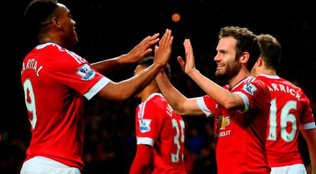 Juan Mata (R) of Manchester United celebrates scoring his team's second goal with his team mate Anthony Martial (L) during the Barclays Premier League match between Manchester United and West Bromwich Albion at Old Trafford on November 7, 2015 in Manchester, England. (Photo by Alex Livesey/Getty Images)