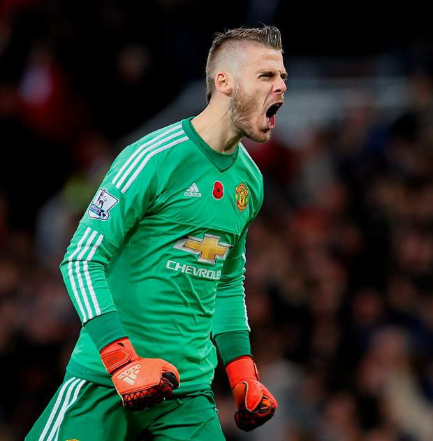 Manchester United's David de Gea celebrates Jesse Lingard's opening goal in yesterday's victory over West Brom at Old Trafford