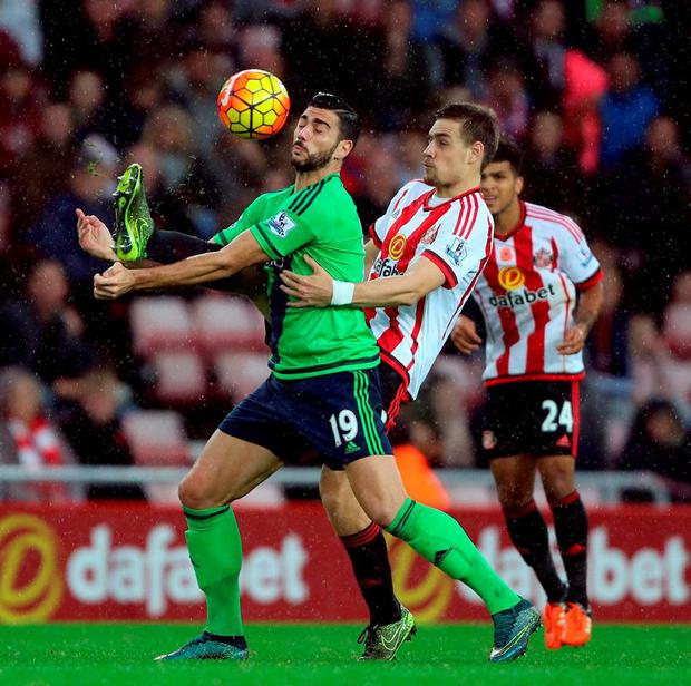 Southampton's Graziano Pelle is challenged by Sunderland's Sebastian Coates