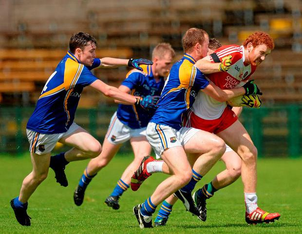 Derry minor Conor Glass, 'who went to Aussie Rules to get a rest', in action against Longford's Peter Lynn, Enda Farrell and Ruairi Harkins