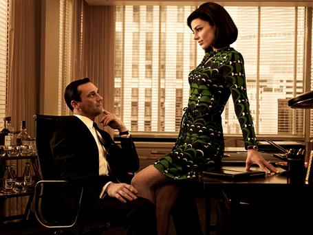 Office politics: Jon Hamm as advertising executive top dog, Don Draper, and Jessica Pare as Megan in a scene from TV series 'Mad Men'