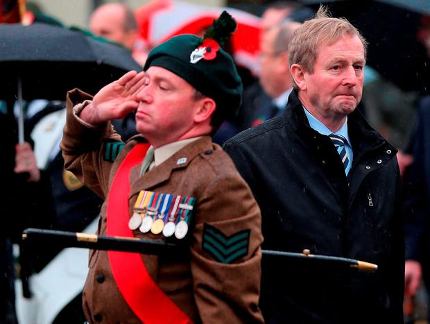 Taoiseach Enda Kenny (right) during Remembrance Sunday at the Cenotaph in Enniskillen, Co Fermanagh, held in tribute for members of the armed forces who have died in major conflicts