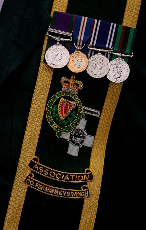 The badge of the Royal Ulster Constabulary George Cross Association during Remembrance Sunday at the Cenotaph in Enniskillen, Co Fermanagh, held in tribute for members of the armed forces who have died in major conflicts