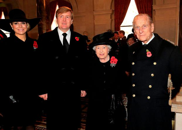 Queen Elizabeth II and the Duke of Edinburgh (right and second right) stand with the King Willem-Alexander and his wife Queen Maxima of the Netherlands, in the Foreign & Commonwealth Office, central London, prior to attending the Cenotaph Remembrance Service, in tribute for members of the armed forces who have died in major conflicts