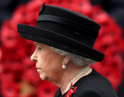 Britain's Queen Elizabeth takes part in the Remembrance Sunday ceremony at the Cenotaph in Westminster, central London, November 8, 2015
