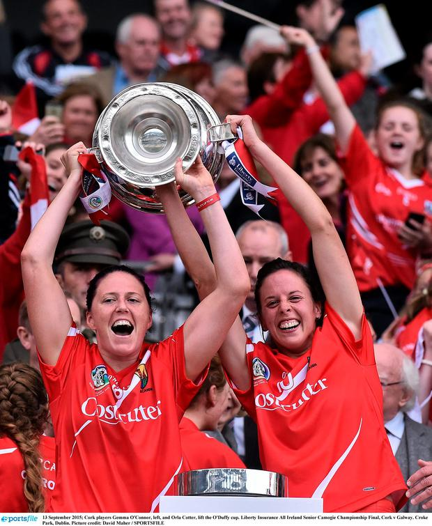 13 September 2015; Cork players Gemma O'Connor, left, and Orla Cotter, lift the O'Duffy cup. Liberty Insurance All Ireland Senior Camogie Championship Final, Cork v Galway. Croke Park, Dublin. Picture credit: David Maher / SPORTSFILE
