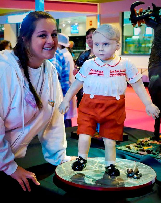 Laura Mason of her with her Prince George cake at the Cake International event held at the NEC in Birmingham, where she won the top Gold award for her creation