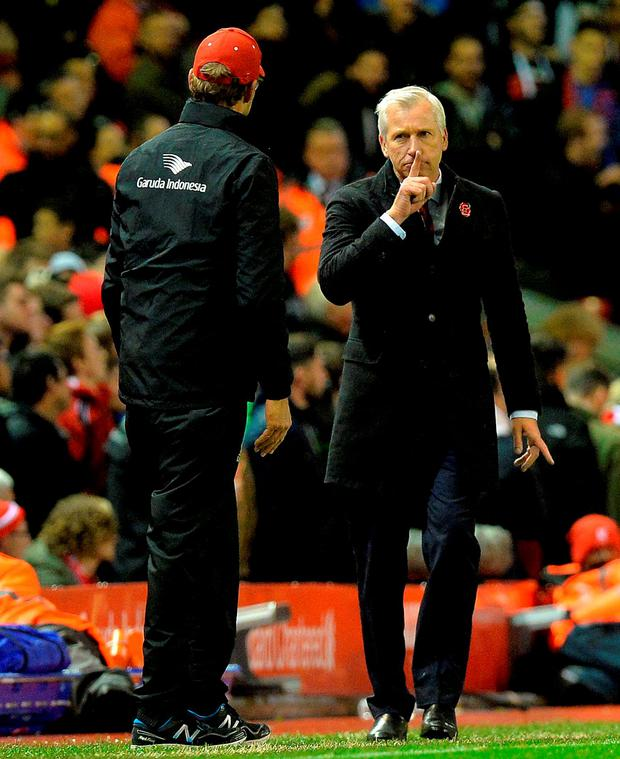 Crystal Palace manager Alan Pardew argues with Liverpool manager Jurgen Klopp
