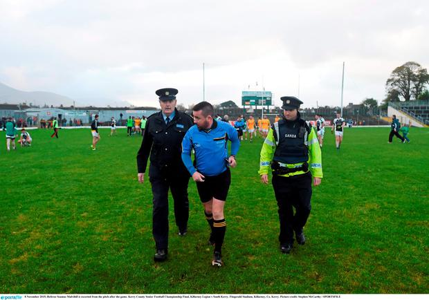 Referee Seamus Mulvihill is escorted from the pitch after the game. Kerry County Senior Football Championship Final, Killarney Legion v South Kerry. Fitzgerald Stadium, Killarney, Co. Kerry. Picture credit: Stephen McCarthy / SPORTSFILE