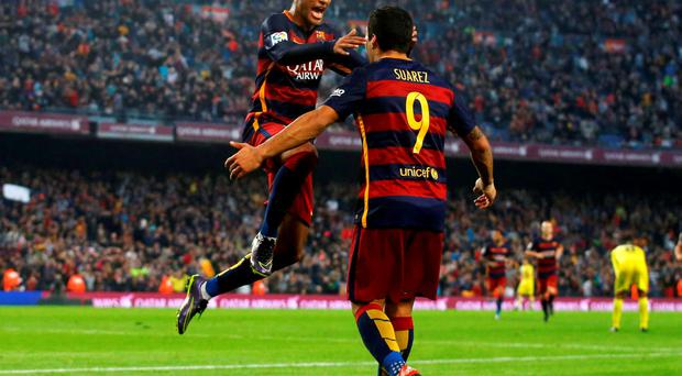 Barcelona's Luis Suarez (R) and Neymar celebrate a goal against Villarreal during their Spanish first division soccer match at Camp Nou stadium in Barcelona, Spain, November 8, 2015. REUTERS/Albert Gea