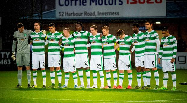 Celtic players join in a minutes silence for Remembrance Sunday