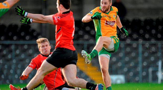 Corofin's Michael Lundy scoring a point dispite the close attentions of St Mary's Stephen Keenan and Jonathan Martyn