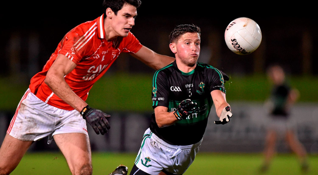 Colin O'Brien, Nemo Rangers, and Shane Aherne of Stradbally battle for possession
