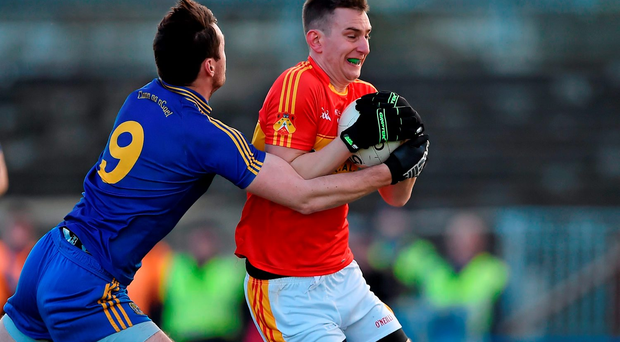 Barry Moran of Castlebar Mitchels attempts to retain possession despite the efforts of Clann na nGael's Donie Shine
