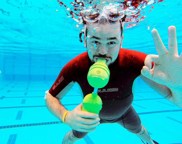 Cathal Redmond, a product and technology design student, pictured with his winning invention 'Express Dive' at the Olympic-sized Pool at the University of Limerick Sports arena. Picture:Marie McCallan/Press 22