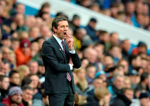 Aston Villa's new French manager Remi Garde looks on as his side holds league leaders City to a goalless draw