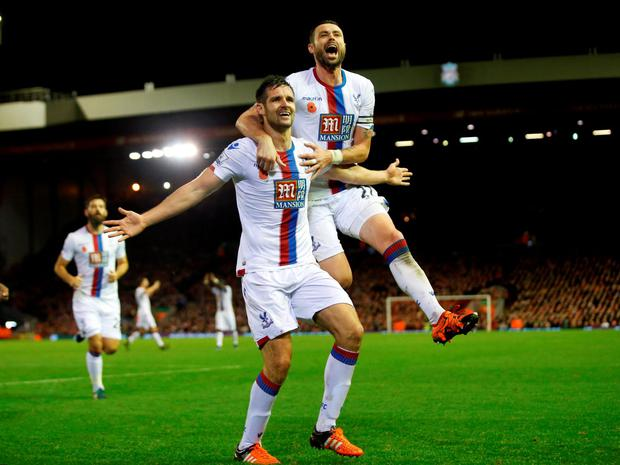 Crystal Palace's Scott Dann celebrates scoring their winning goal alongside Damien Delaney
