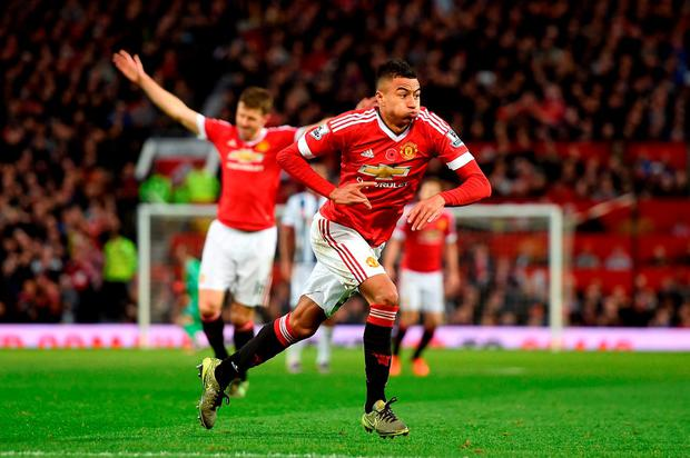 Manchester United's Jesse Lingard celebrates scoring their first goal of the game