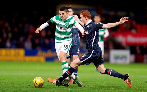 Ross County's Scott Boyd (Right) in action with Celtic's Tom Rogi
