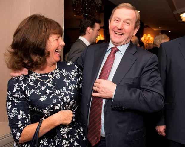 Taoiseach Enda Kenny shares a laugh with Finola Bruton as he celebrates 40 years in the Dáil with friends and supporters at Breaffy House Resort in Castlebar, Co Mayo. Photo: Michael McLaughlin