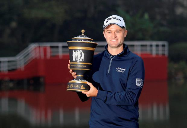 Russell Knox of Scotland poses with the trophy after winning the WGC-HSBC Champions golf tournament in Shanghai