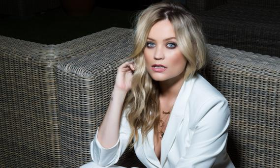 Blonde on the run: Laura Whitmore wears - Suit; shoes, River Island. Photo: Kip Carroll