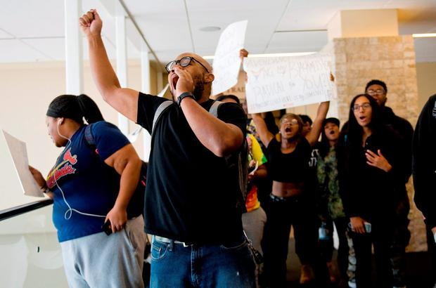 Students chant during an anti-racism demonstration inside the University of Missouri Student Center in Columbia Credit: Daniel Brenner/Columbia Daily Tribune via AP