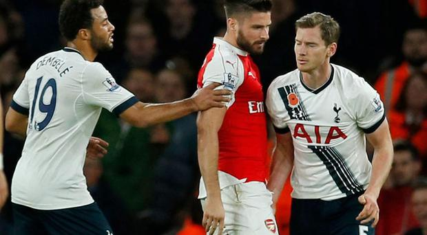 Jan Vertonghen appears to grab Arsenal striker Olivier Giroud. Reuters