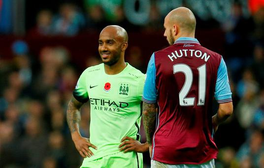 Manchester City's Fabian Delph and Aston Villa's Alan Hutton during yesterday's encounter at Villa Park Action Images via Reuters / Jason Cairnduff
