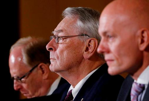 Richard W. Pound, (C) World Anti-Doping Agency (WADA) Founding President and former IOC Vice President speaks next to Richard H. McLaren (L), Legal Counsel and member of the Court of Arbitration for Sport (CAS) and Guenter Younger, Head of Department Cybercrime with Bavarian Landeskriminalamt (LKA) during a news conference on the WADA Independent Commission report on findings of investigation into allegations of widespread doping in sport in Geneva. REUTERS/Denis Balibouse