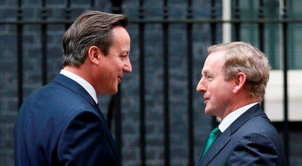 Britain's Prime Minister David Cameron meets Enda Kenny outside of 10 Downing Street in London, Britain November 9, 2015