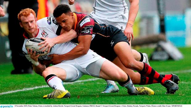 8 November 2015; Peter Nelson, Ulster, is tackled by Ashton Hewitt, Newport Gwent Dragons. Guinness PRO12, Round 7, Newport Gwent Dragons v Ulster. Rodney Parade, Newport, Wales. Picture credit: Huw Evans / SPORTSFILE