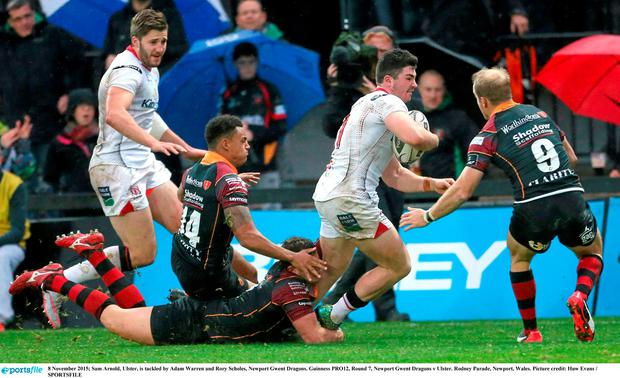 8 November 2015; Sam Arnold, Ulster, is tackled by Adam Warren and Rory Scholes, Newport Gwent Dragons. Guinness PRO12, Round 7, Newport Gwent Dragons v Ulster. Rodney Parade, Newport, Wales. Picture credit: Huw Evans / SPORTSFILE
