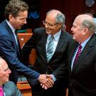 Dutch Finance Minister and Eurogroup chairman Jeroen Dijsselbloem (2nd L) greets Irish Finance Minister Michael Noonan (R) while German Finance Minister Wolfgang Schaeuble (L) looks on at a euro zone finance ministers meeting in Brussels, Belgium, November 9, 2015