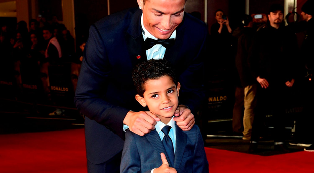 Cristiano Ronaldo, and his son Cristiano Ronaldo Junior attending the world premiere of Ronaldo at Vue West End Cinema in Leicester Square, London. PRESS ASSOCIATION Photo. Picture date: Monday 9th November, 2015. Photo credit should read: Ian West/PA Wire