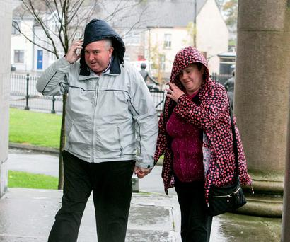 The girls' mother Frances holds her husband John Joe Patterson's hand as they arrive at Nenagh Court. Photo: Brian Gavin Press 22