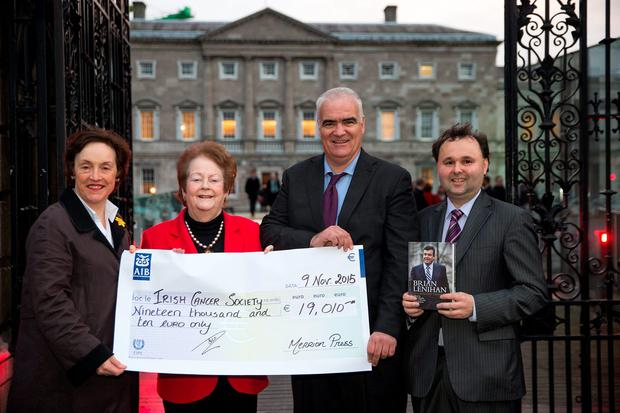 From left: Kathleen O'Meara, of the Irish Cancer Society, receives a cheque from Mary O'Rourke, Noel Whelan and Dr Brian Murphy for royalties from a book about Brian Lenihan at Leinster House yesterday. Photo: Arthur Carron