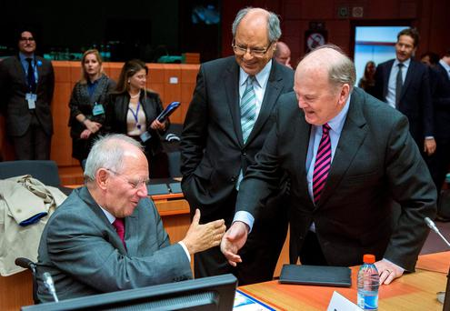 Michael Noonan greets German Finance Minister Wolfgang Schaeuble in Brussels yesterday
