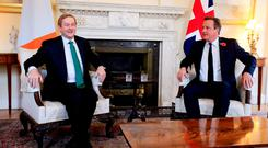 British Prime Minister David Cameron welcomes Taoiseach Enda Kenny to 10 Downing Street in London yesterday. Photo: PA