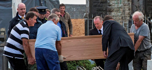 PIC SHOWS: The remains of Margot Seery are removed from Rathkeale parish graveyard, Rathkeale, Co. Limerick. TUES 16-9-14