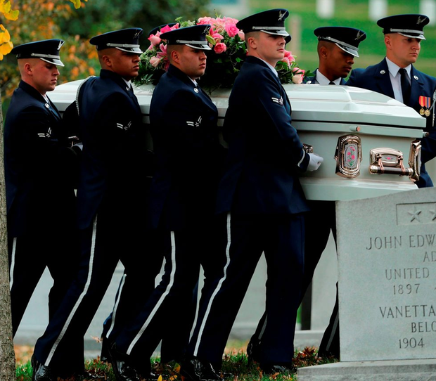 ARLINGTON, VA - NOVEMBER 09: An Air Force Honor Guard casket team moves Maureen O'Hara, also known as Maureen FitzSimons Blair, into place before she is buried next to her husband, Air Force Brig. Gen. Charles Blair Jr., at Arlington National Cemetery November 9, 2015 in Arlington, Virginia. An actress and singer who was known as the Queen of Technicolor and starred in movies including
