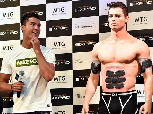 Cristiano Ronaldo casts an eye over his lookalike figure made by a 3D printer during a promotional event in Tokyo in July Getty Images