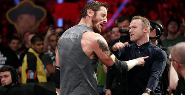 Wayne Rooney delivers the Smackdown as he slaps Barrett across the face WWE.com