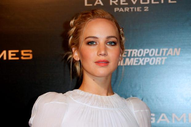 US actress Jennifer Lawrence poses on the red carpet upon her arrivel for