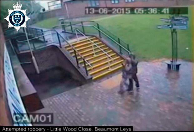 Handout CCTV still issued by Leicestershire Police of a man kicking and stamping on a 66-year-old woman as he tried to snatch her bag in Beaumont Leys, Leicester Leicestershire Police/PA Wire