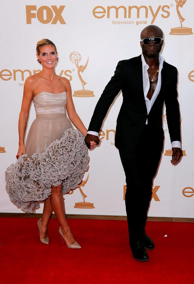 TV personality Heidi Klum (L) and singer Seal arrive at the 63rd Annual Primetime Emmy Awards held at Nokia Theatre L.A. LIVE on September 18, 2011 in Los Angeles, California. (Photo by Frazer Harrison/Getty Images)